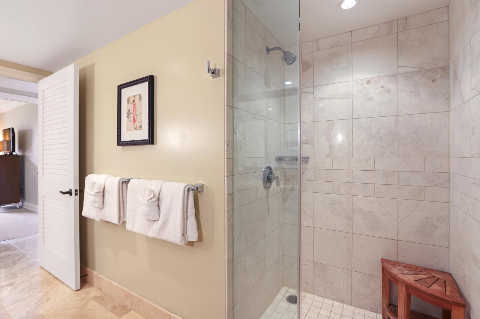 Floor to ceiling glass enclosed shower