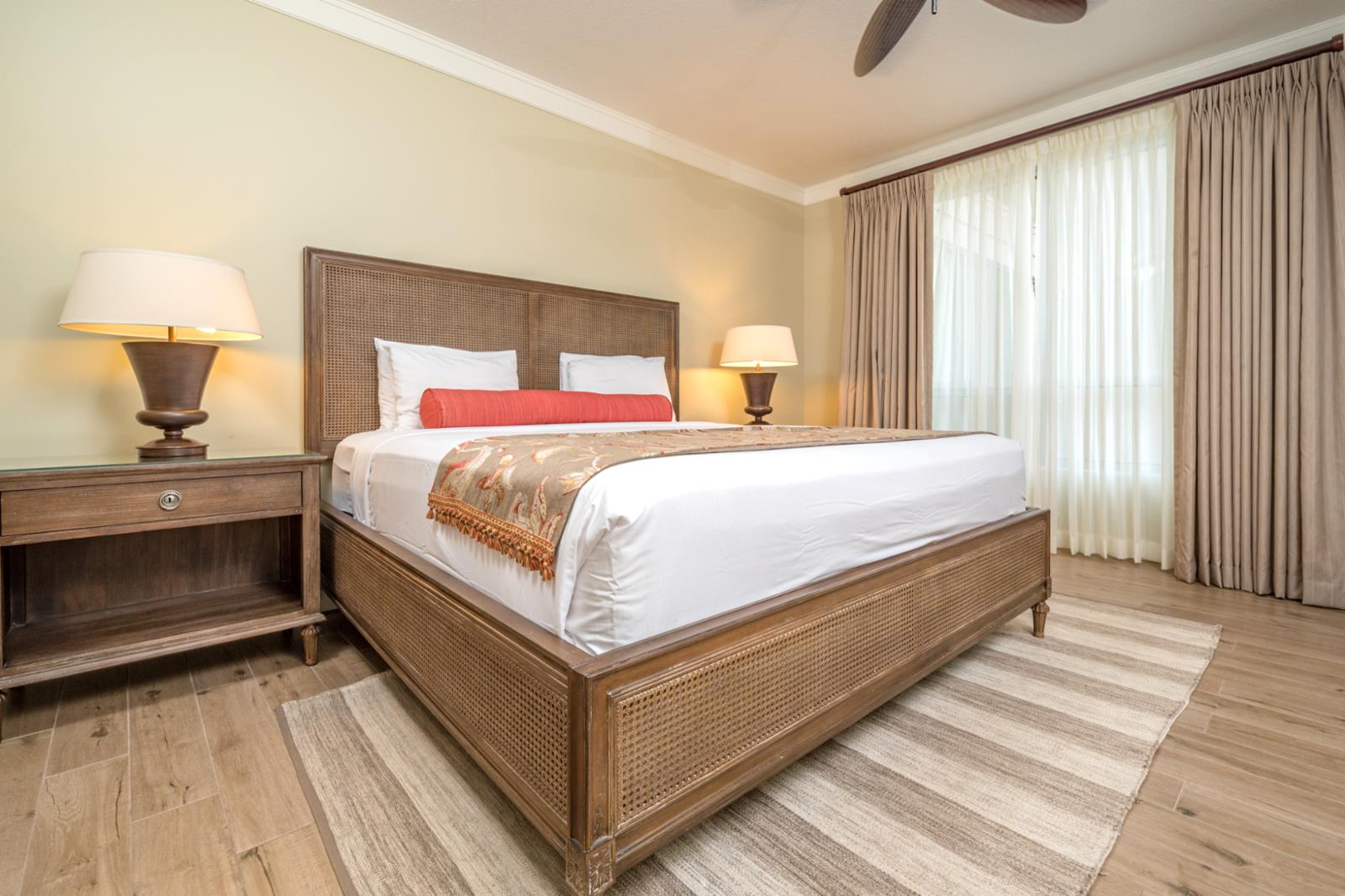 Large guest suite with upgraded ceiling fan and chic interiors