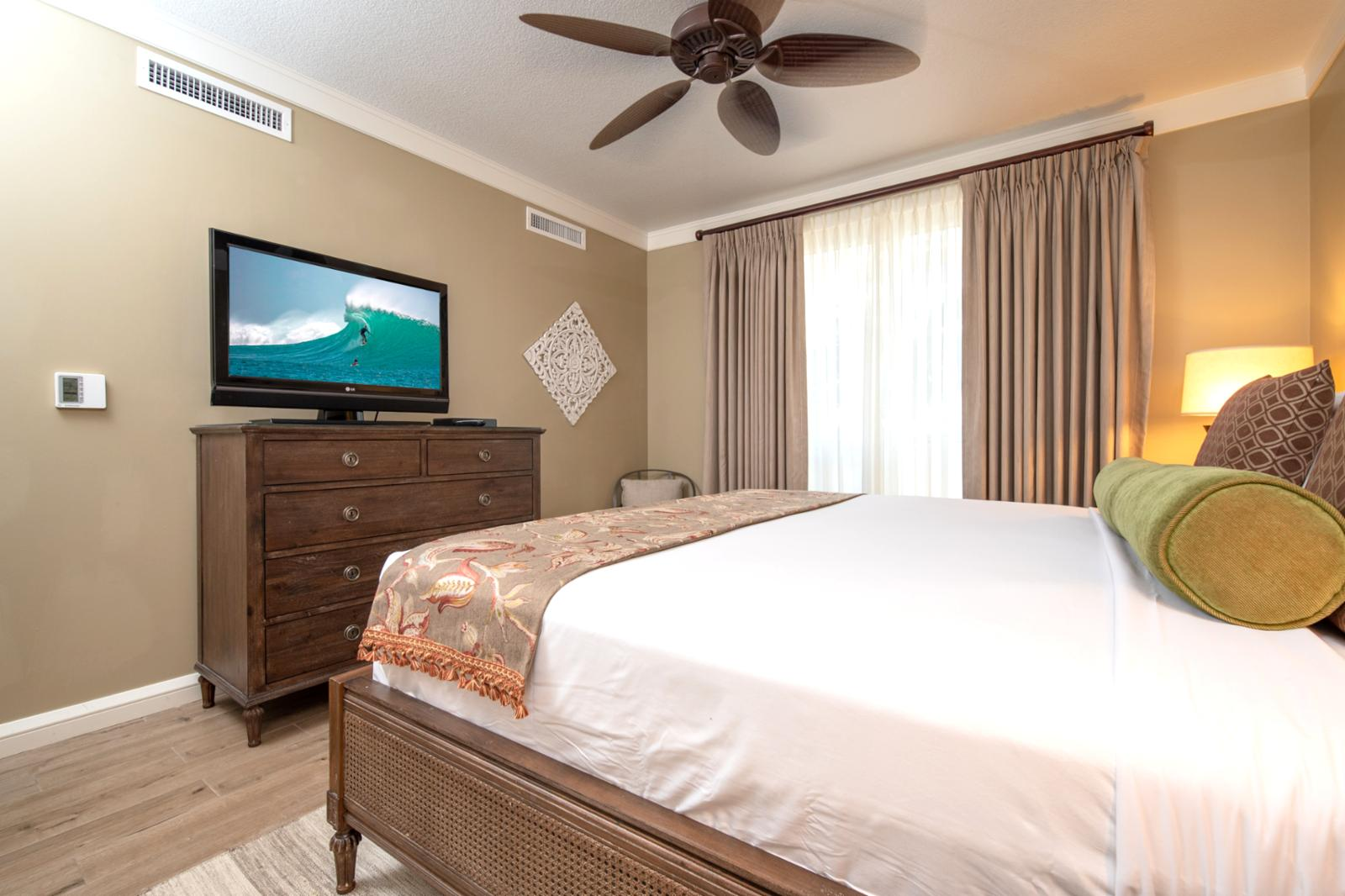 Large flat screen television and equipped with new ceiling fans