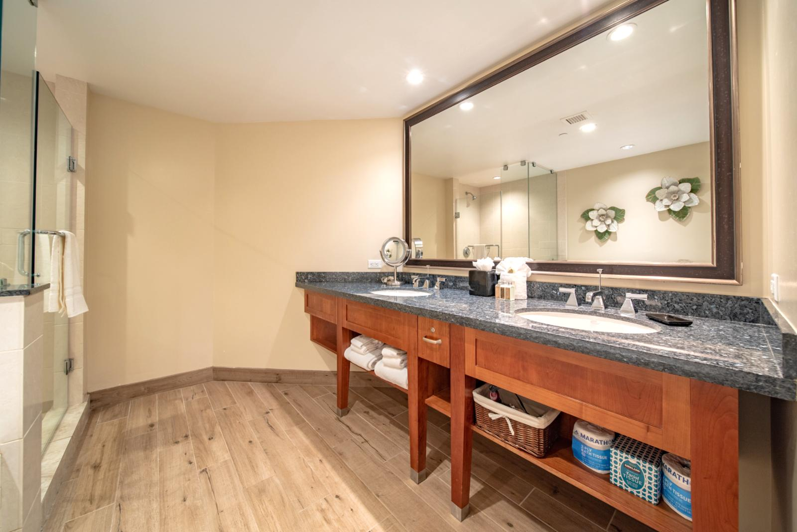 Large guest bathroom suite with dual custom sinks