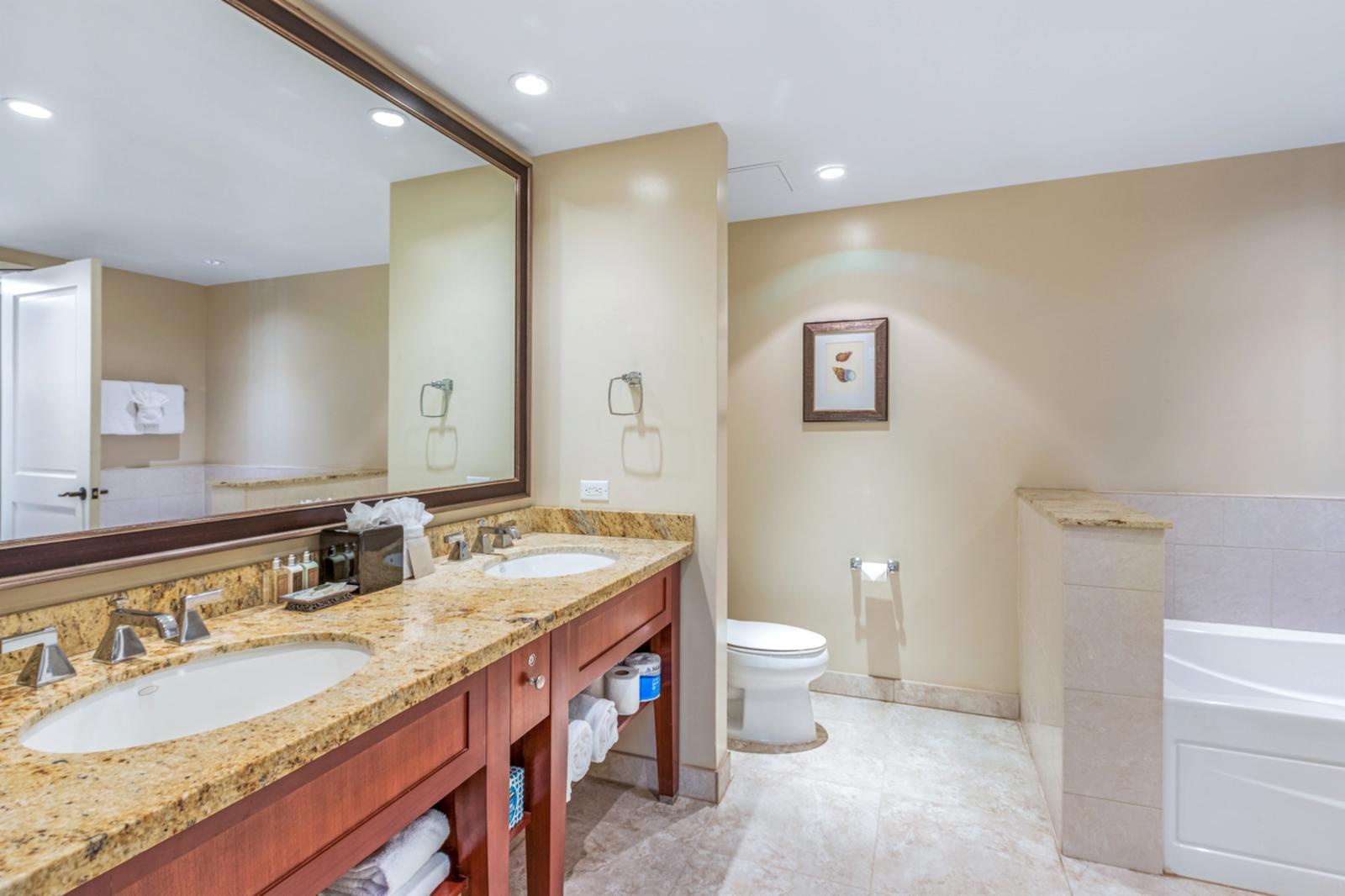 Custom dual sinks complete with luxury amenities