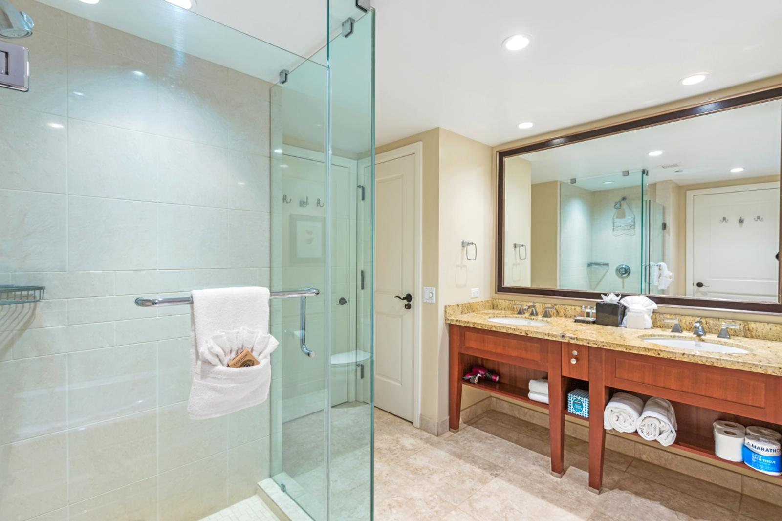Floor to ceiling glass enclosed shower with premium accent lighting