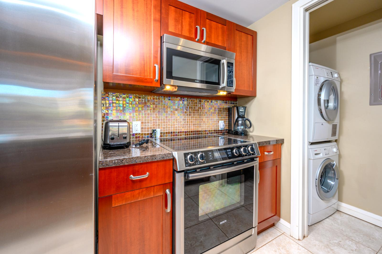 Off the kitchen is a small laundry room with a washer and dryer for your use.
