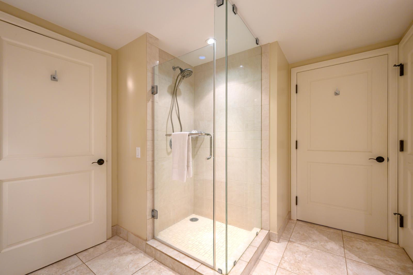 Floor to ceiling glass shower!