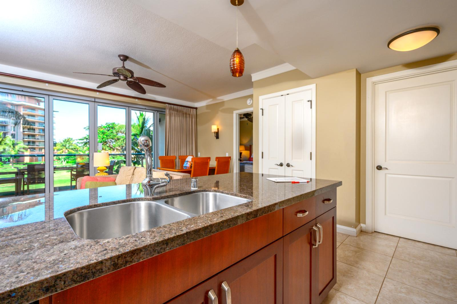 Looking out over the kitchen counter to the living space and open lanai offers a spacious feel.