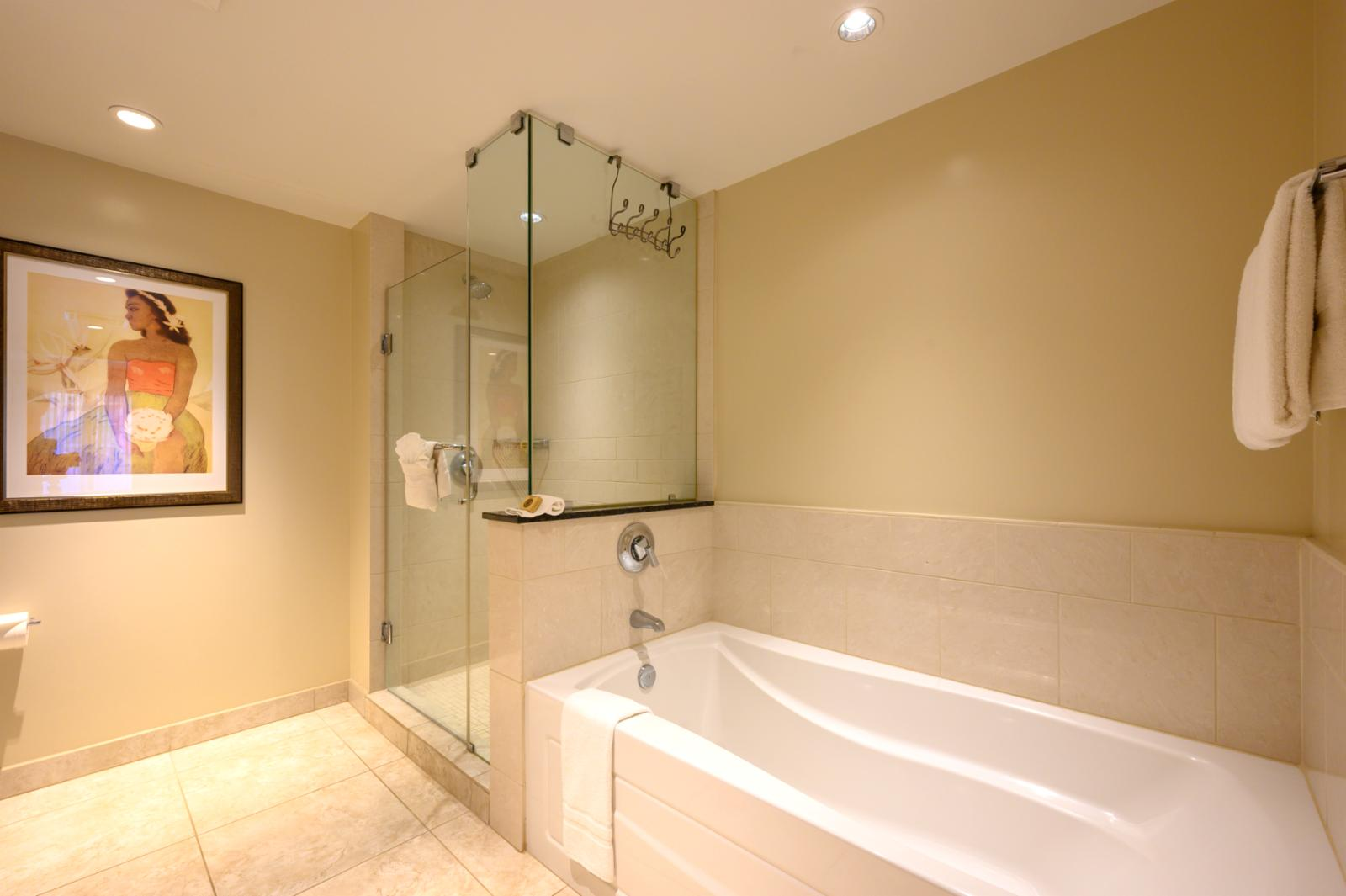 Large bathtub and separate glassed in shower