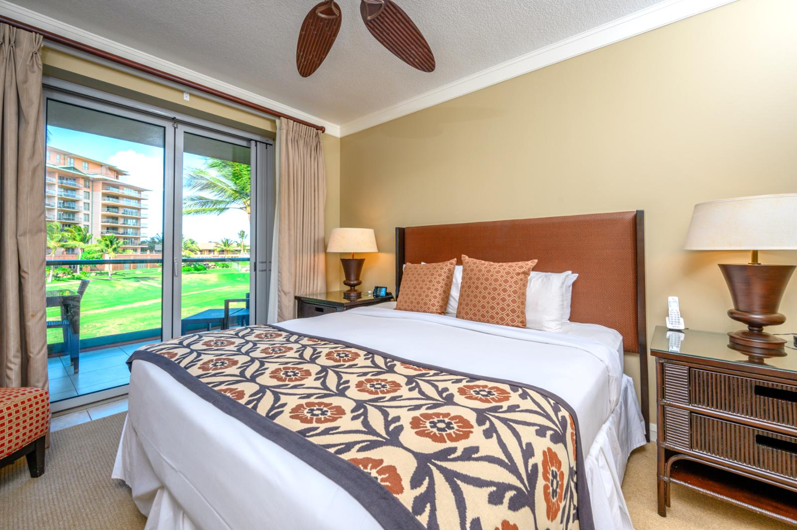Large master bedroom with private lanai access.
