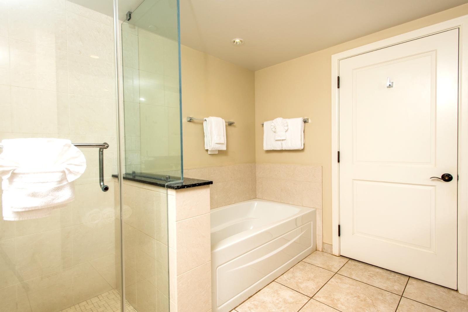 Reverse view showing floor to ceiling enclosed glass shower