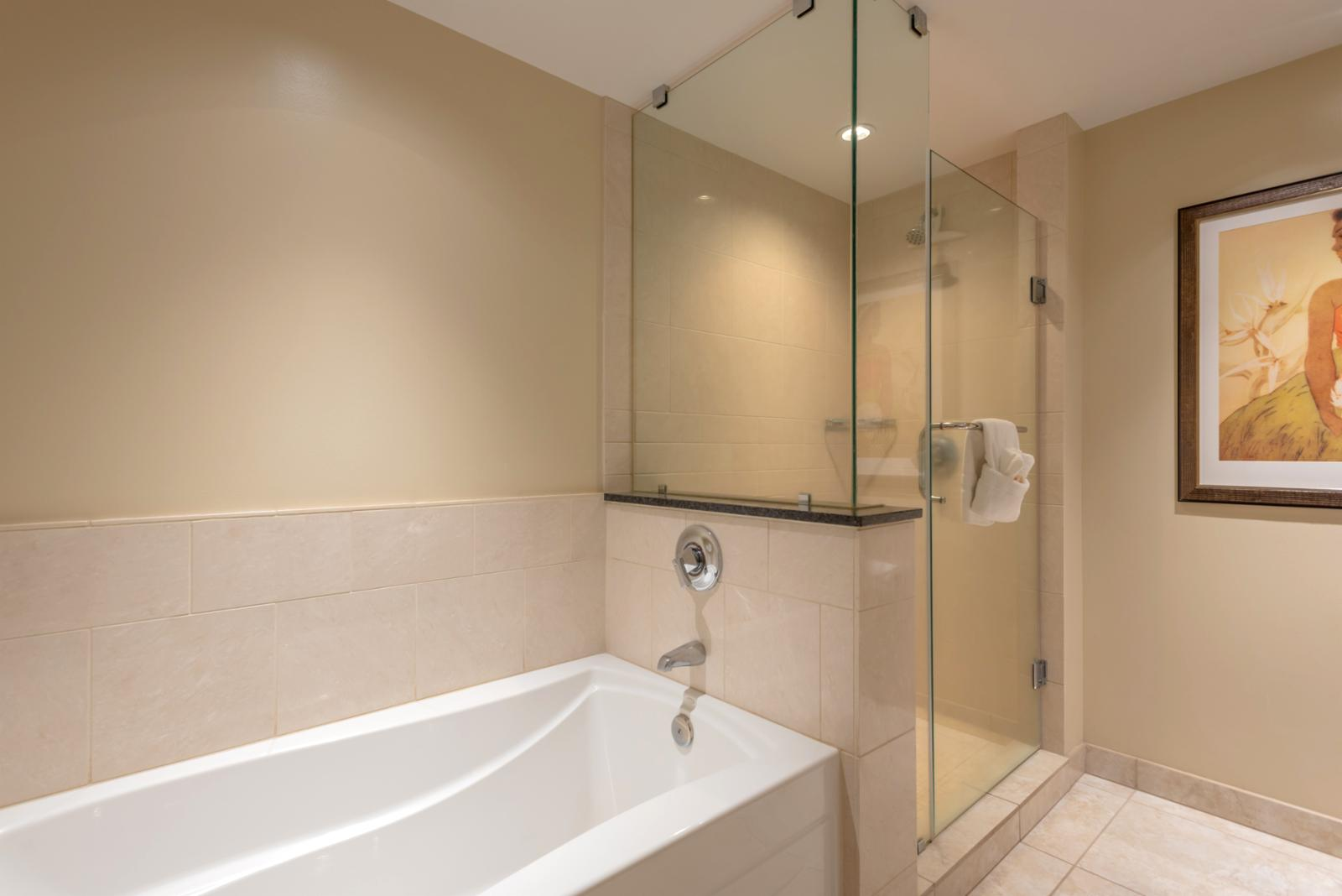 Reverse shot of bathtub and floor to ceiling glass shower