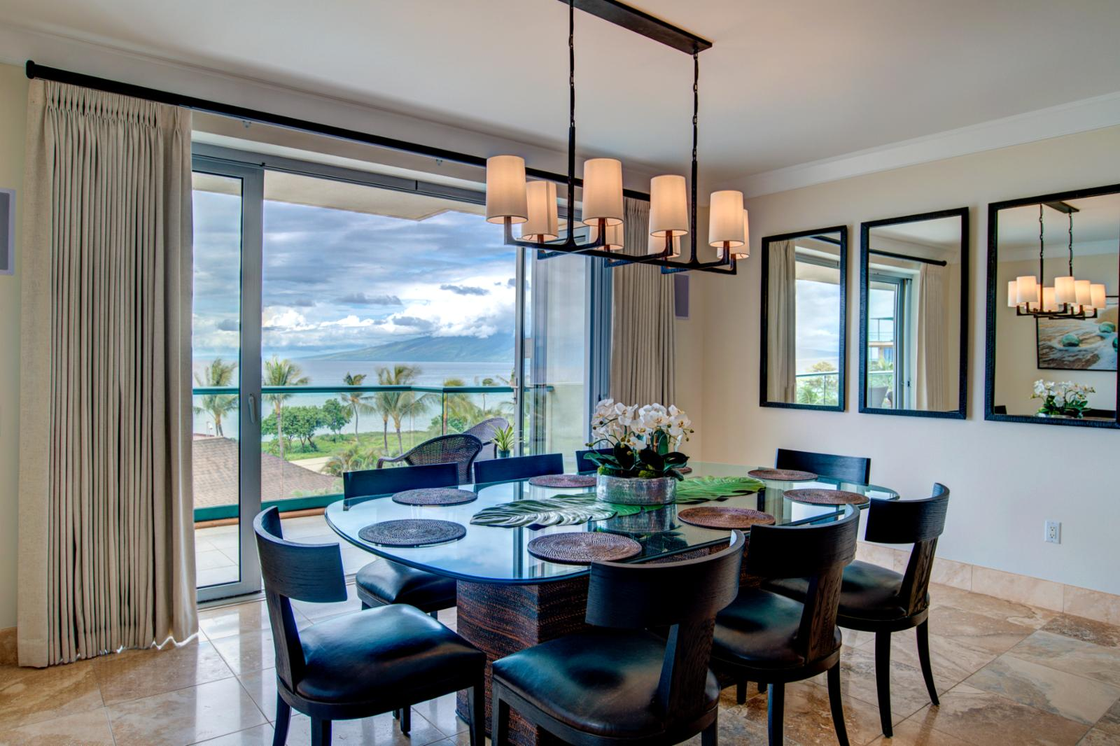 New formal dining room table seating for (8), accent lighting with unparalleled ocean views
