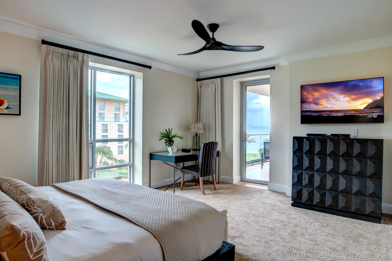 New ceiling fan, flatscreen television and private entry to the balcony from the master suite