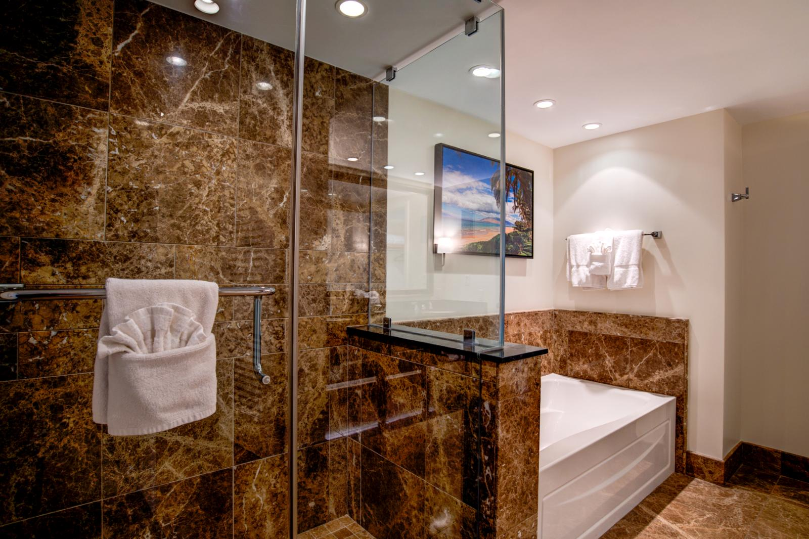 Alternate angle showing the floor to ceiling glass enclosed shower
