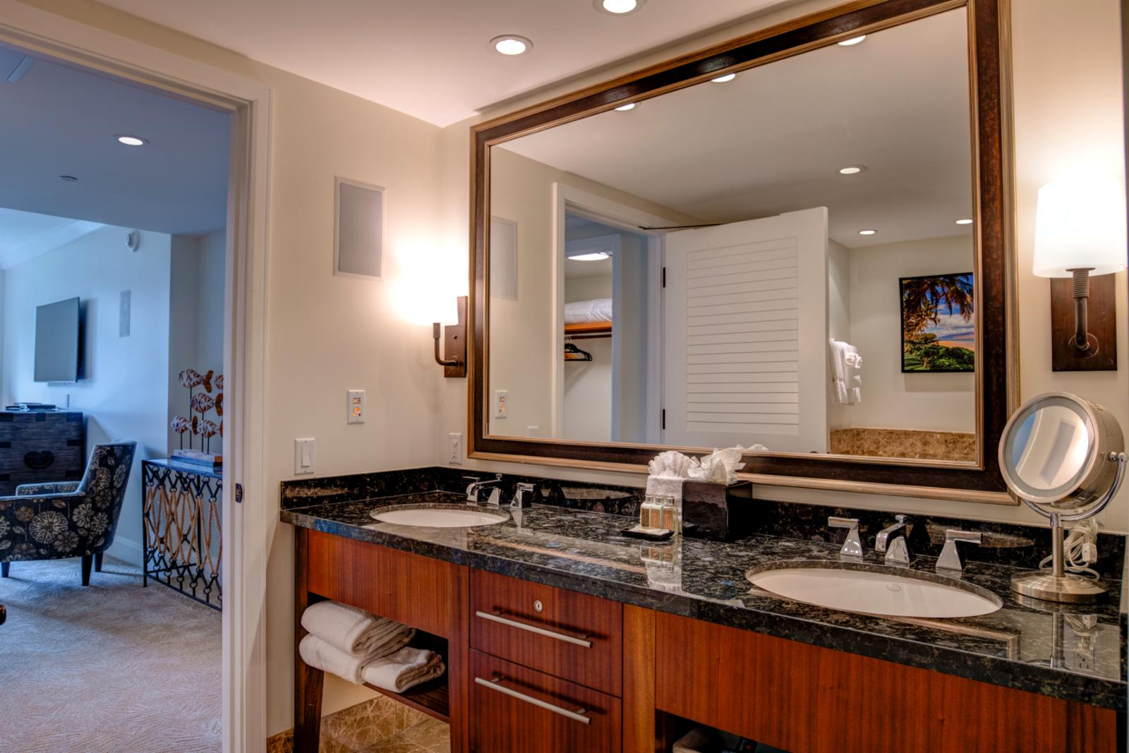 Custom dual sinks, accent mirror backlighting and large comfortable layout