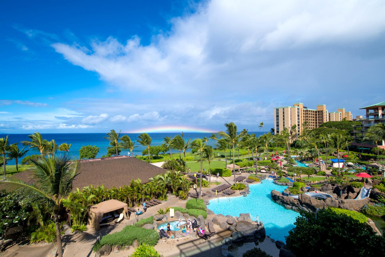 Sweeping views of both Konea and Hokulani Tower pools and resort grounds