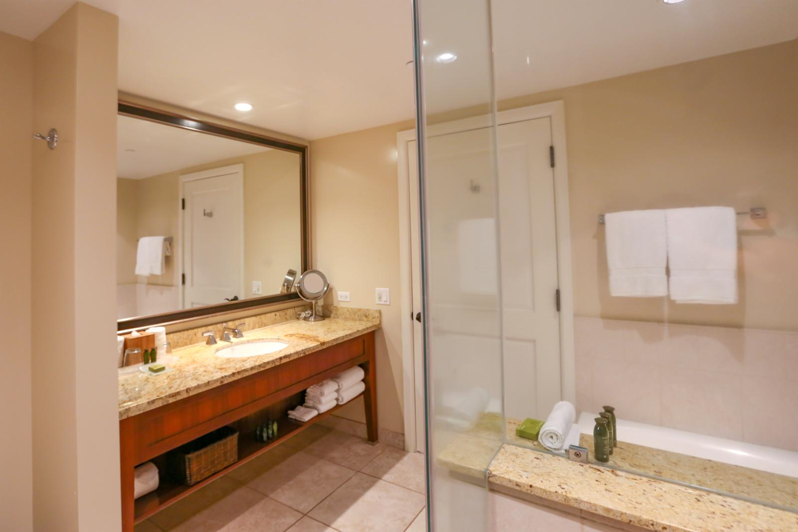 Floor to ceiling glass enclosed shower in this LARGE bath room