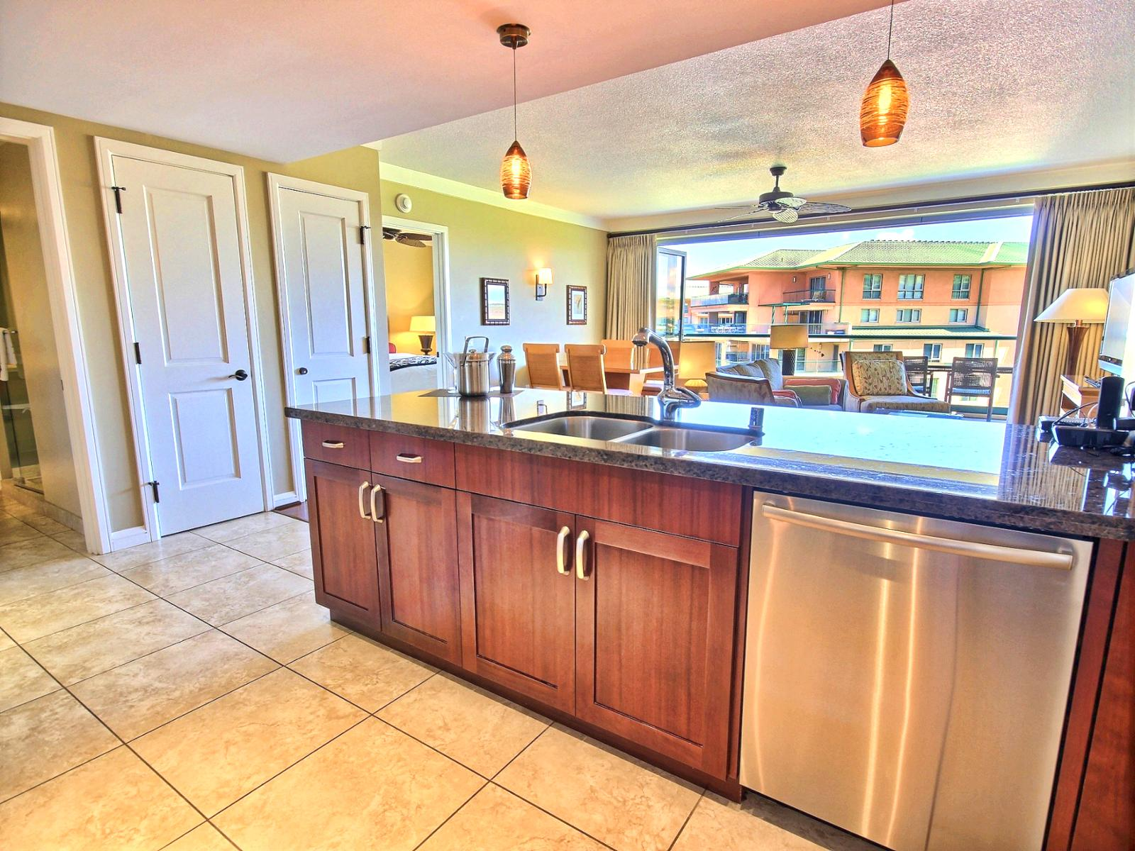 Large gourmet kitchen with granite counter tops. Looking out into the living room from the kitchen.