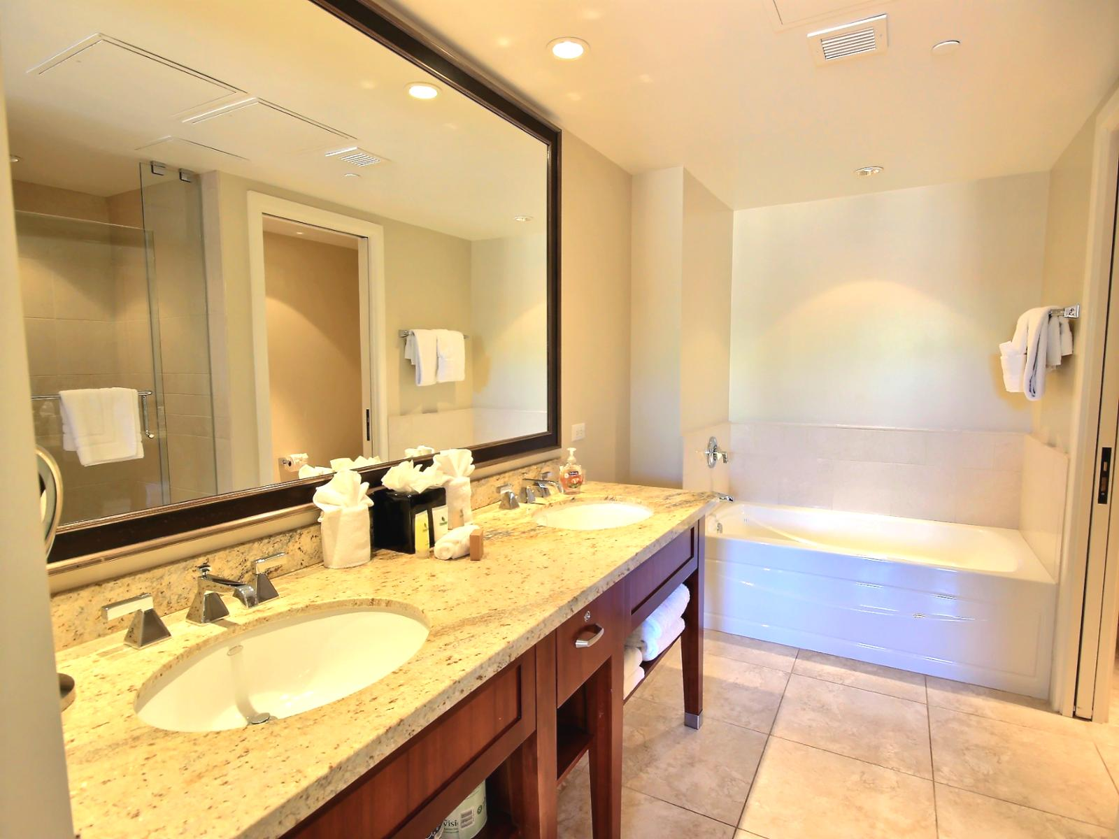 Large dual sink master bathroom with extra large vanity mirror.