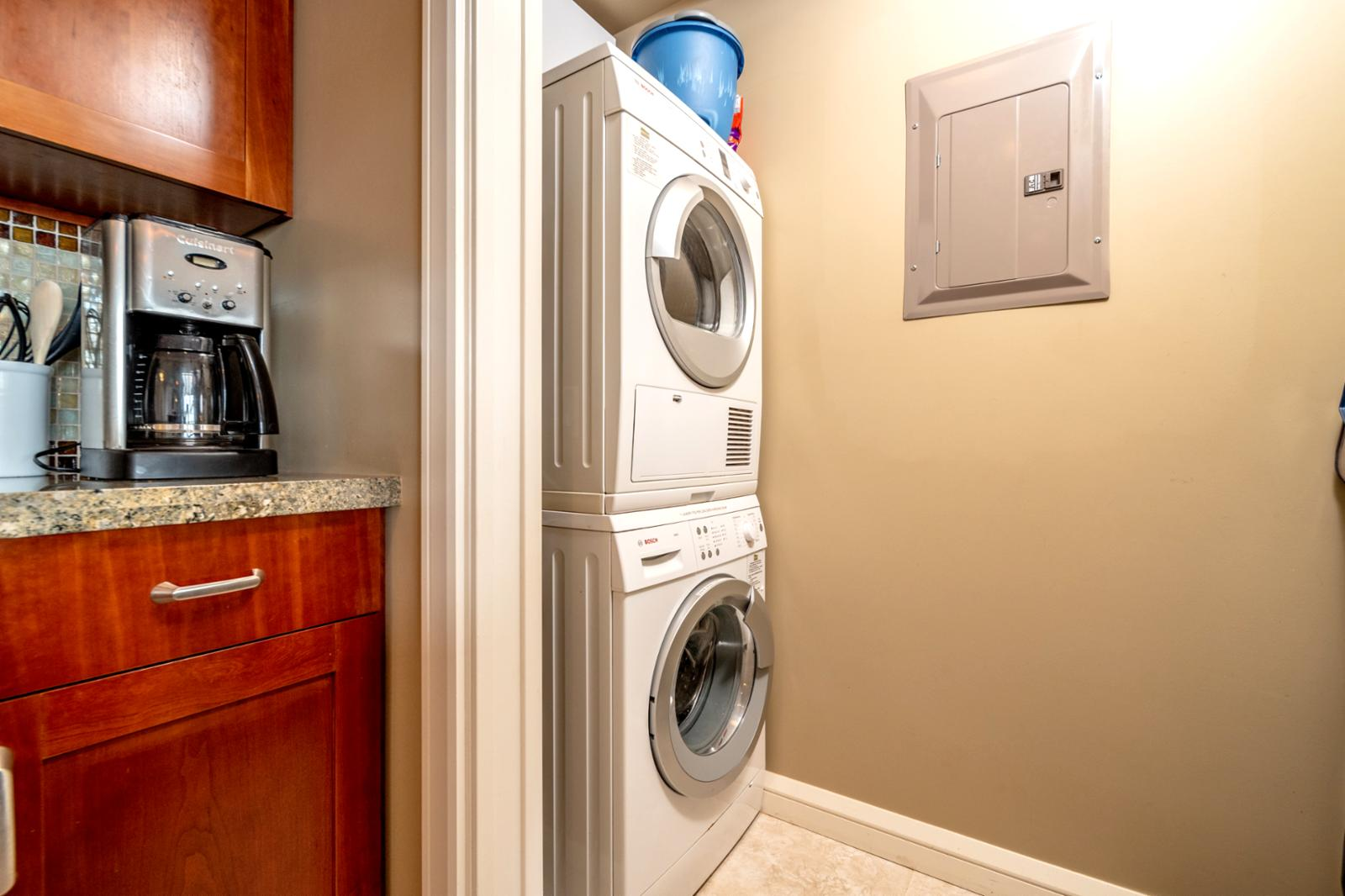 Separate oversized utility closet with BOSCH washer and dryer in unit
