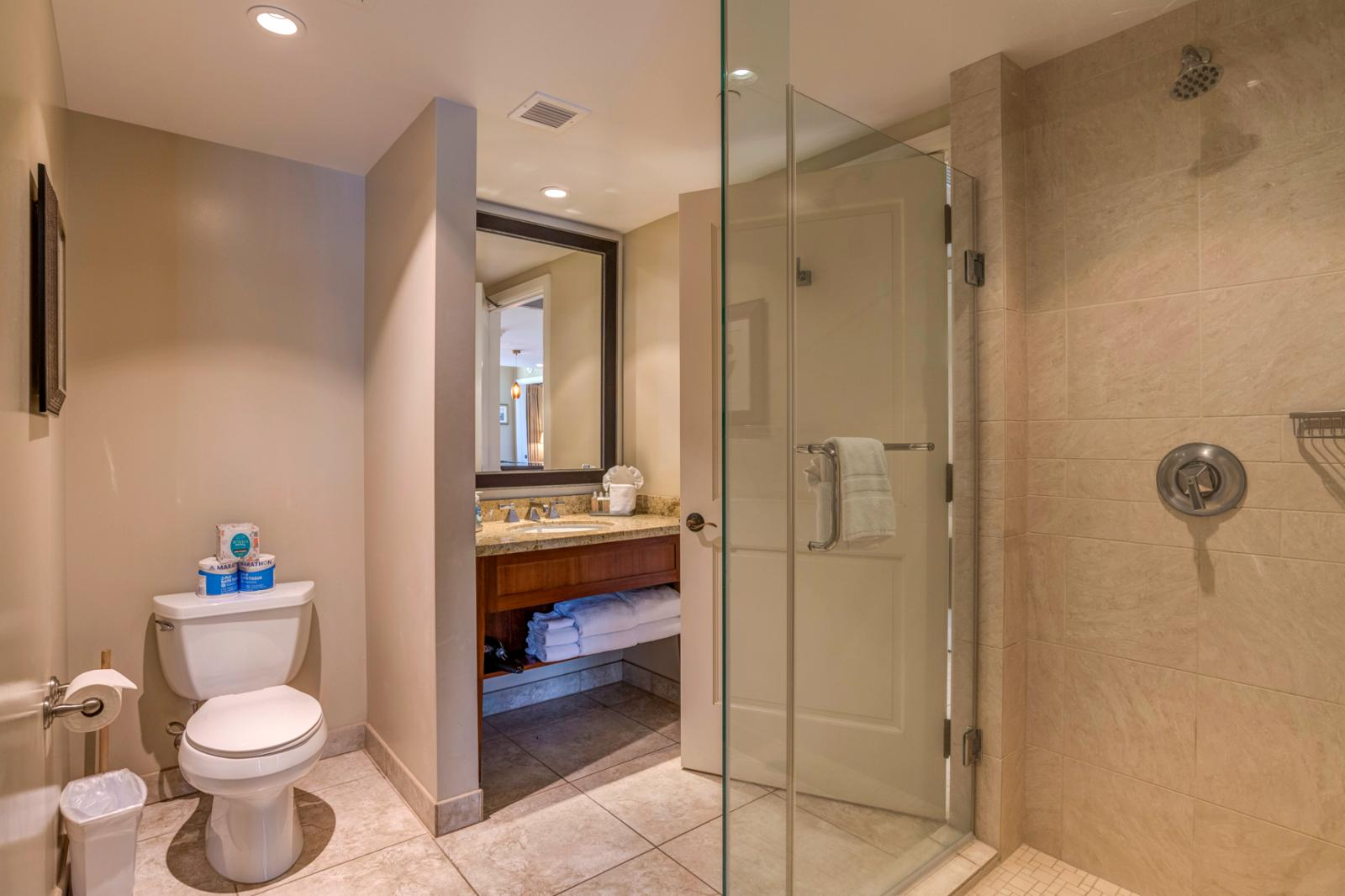 Hallway access, glass enclosed shower with a generous layout