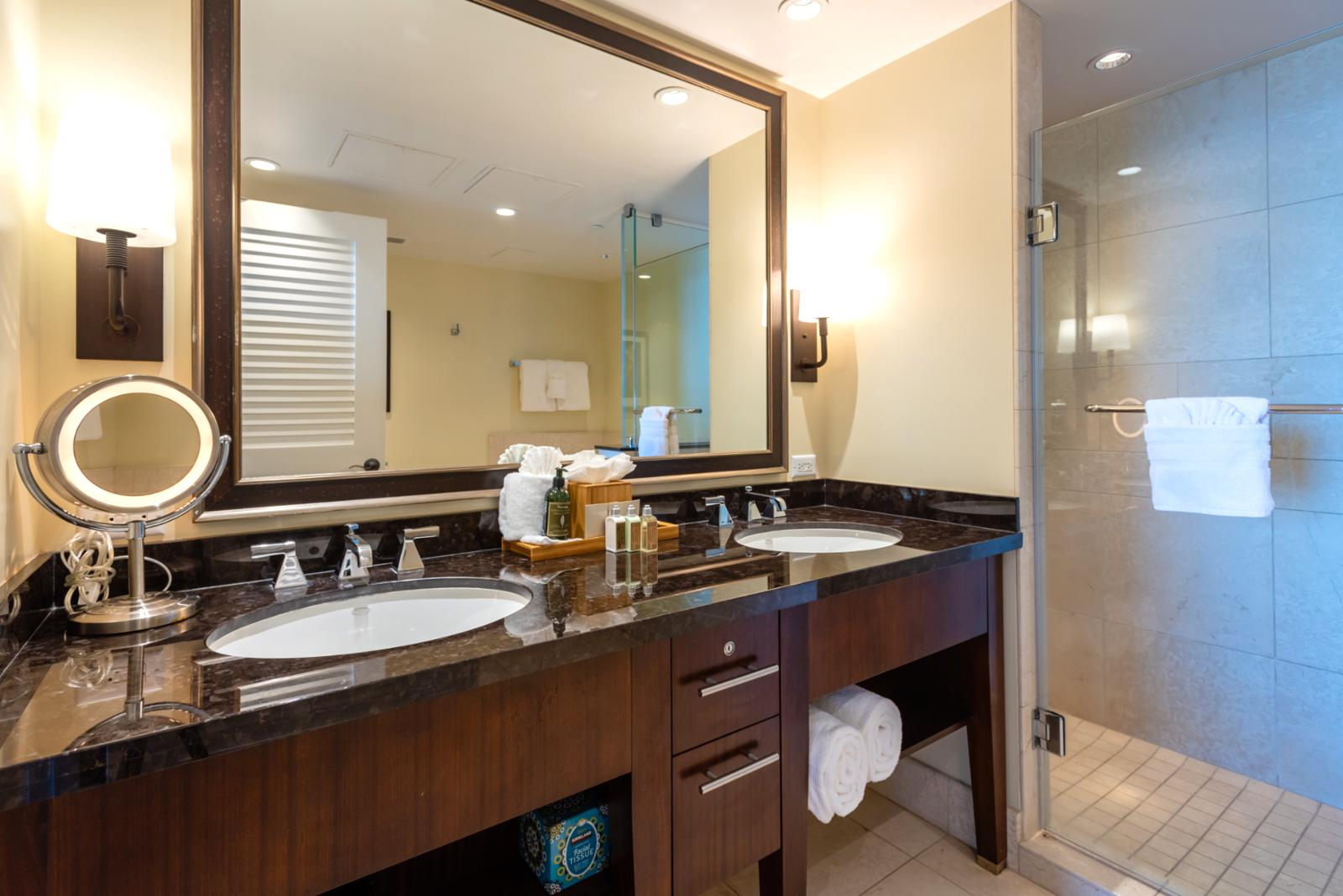 Dual sinks with large glass shower entry