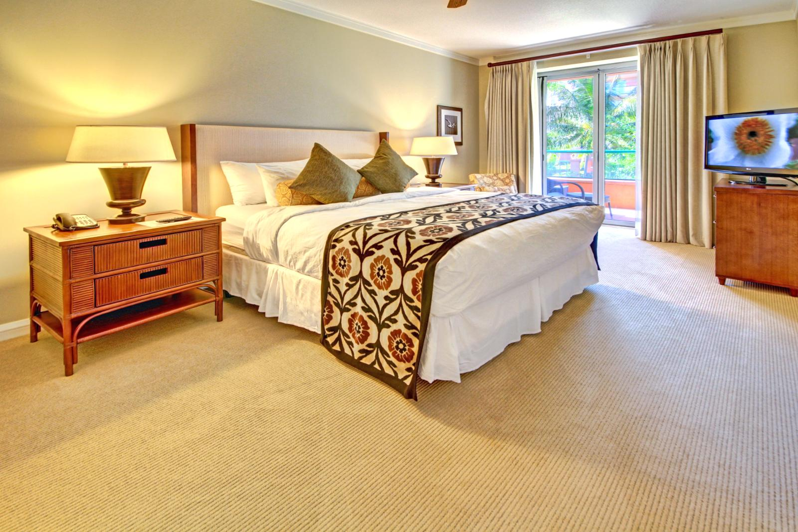 Large master suite with private lanai access.