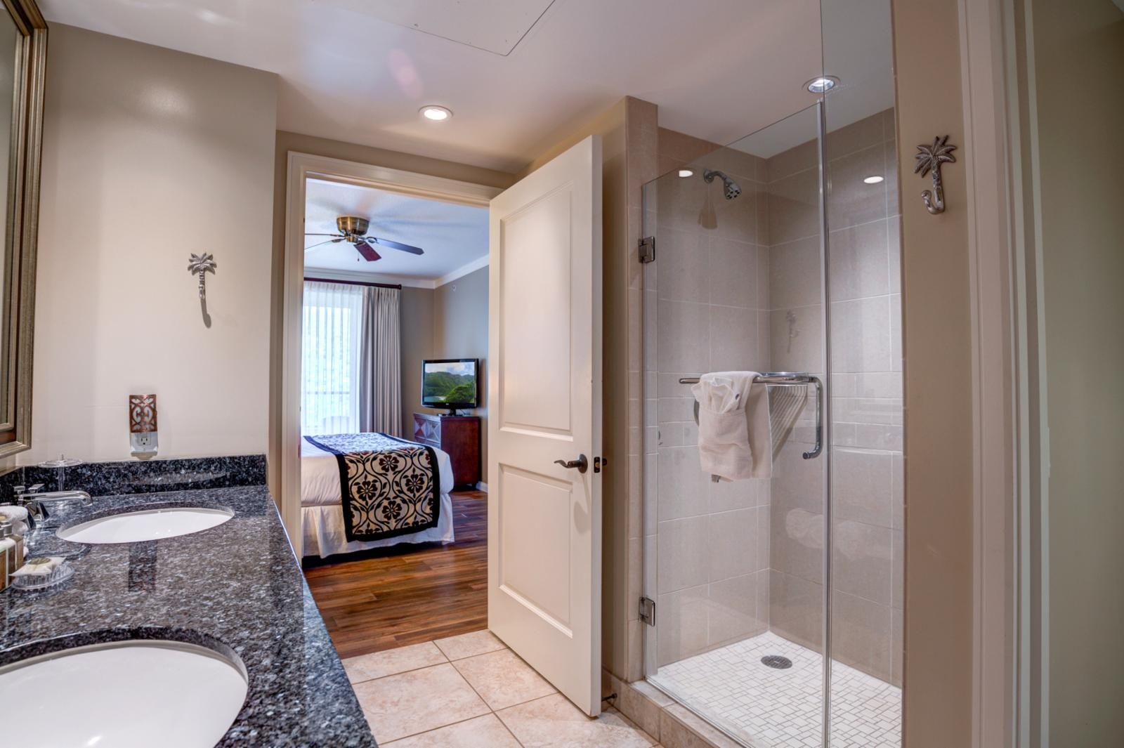 Floor to ceiling glass enclosed luxury shower