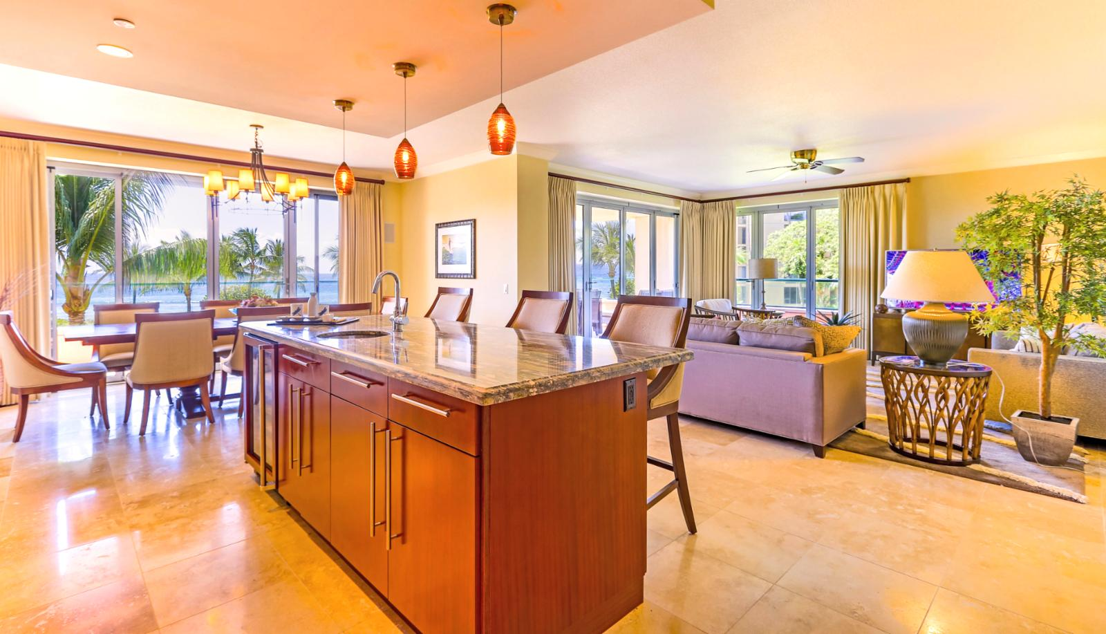 This large great room with the kitchen, living and dining all in one with a view from every seat.