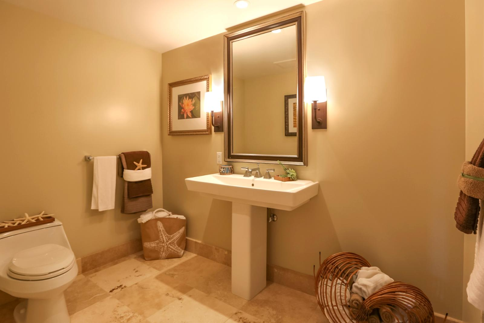 Guest bathroom features a large stand alone shower.