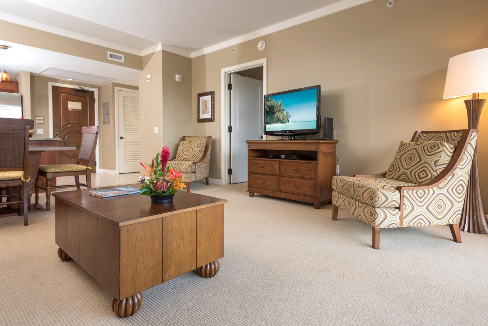 There is a large LG flatscreen TV and comfy lounge chairs in the living room.