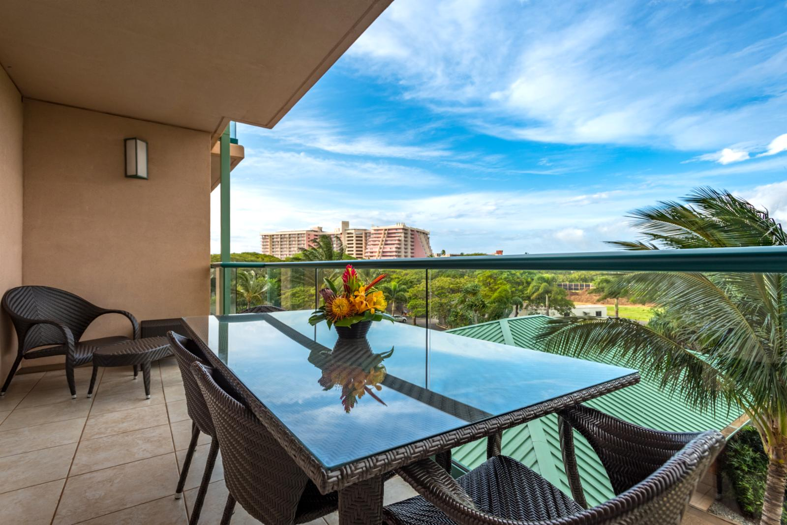 Spacious balcony with comfortable furniture - perfect for cool breezes and relaxing while on vacation!