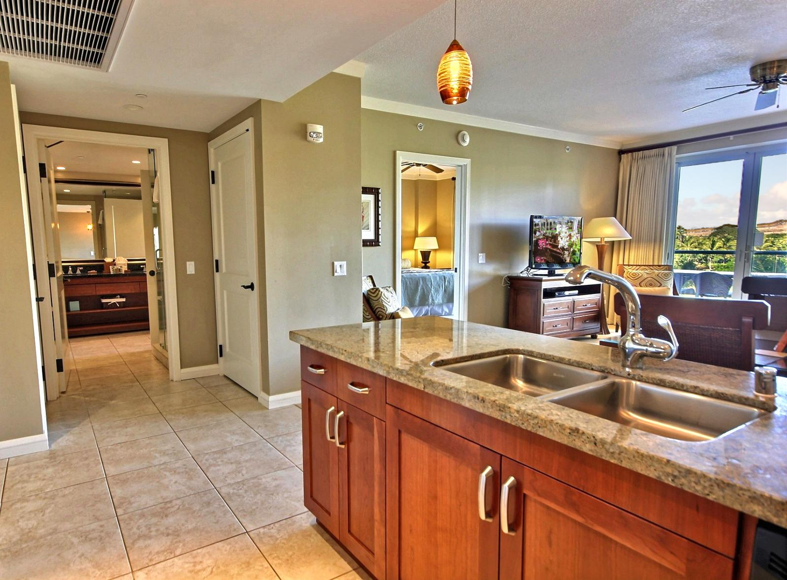 Notice the dual kitchen sinks and full size dish washer makes cleaning up easy