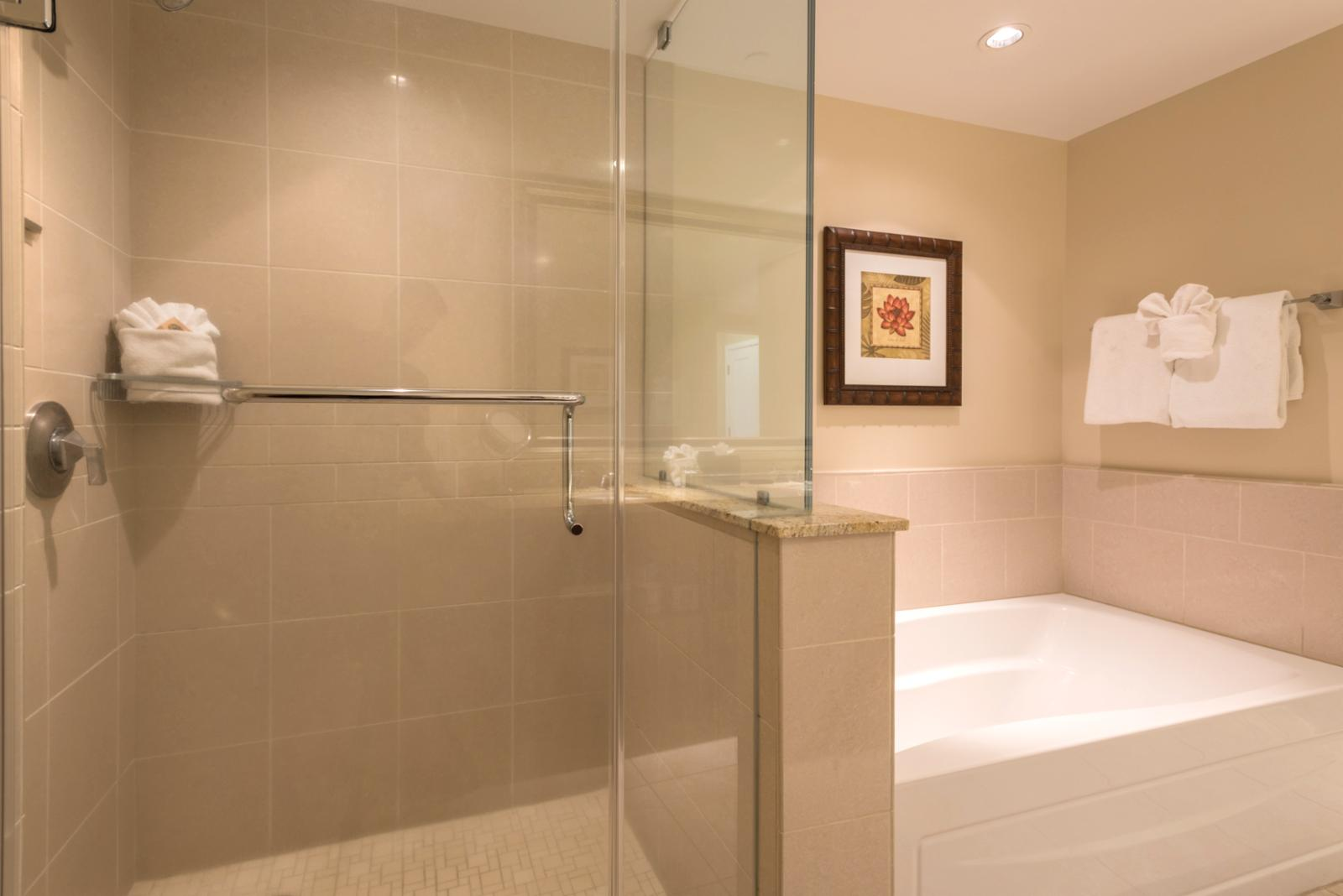 Master bathroom is complete with a glass enclosed shower and bath
