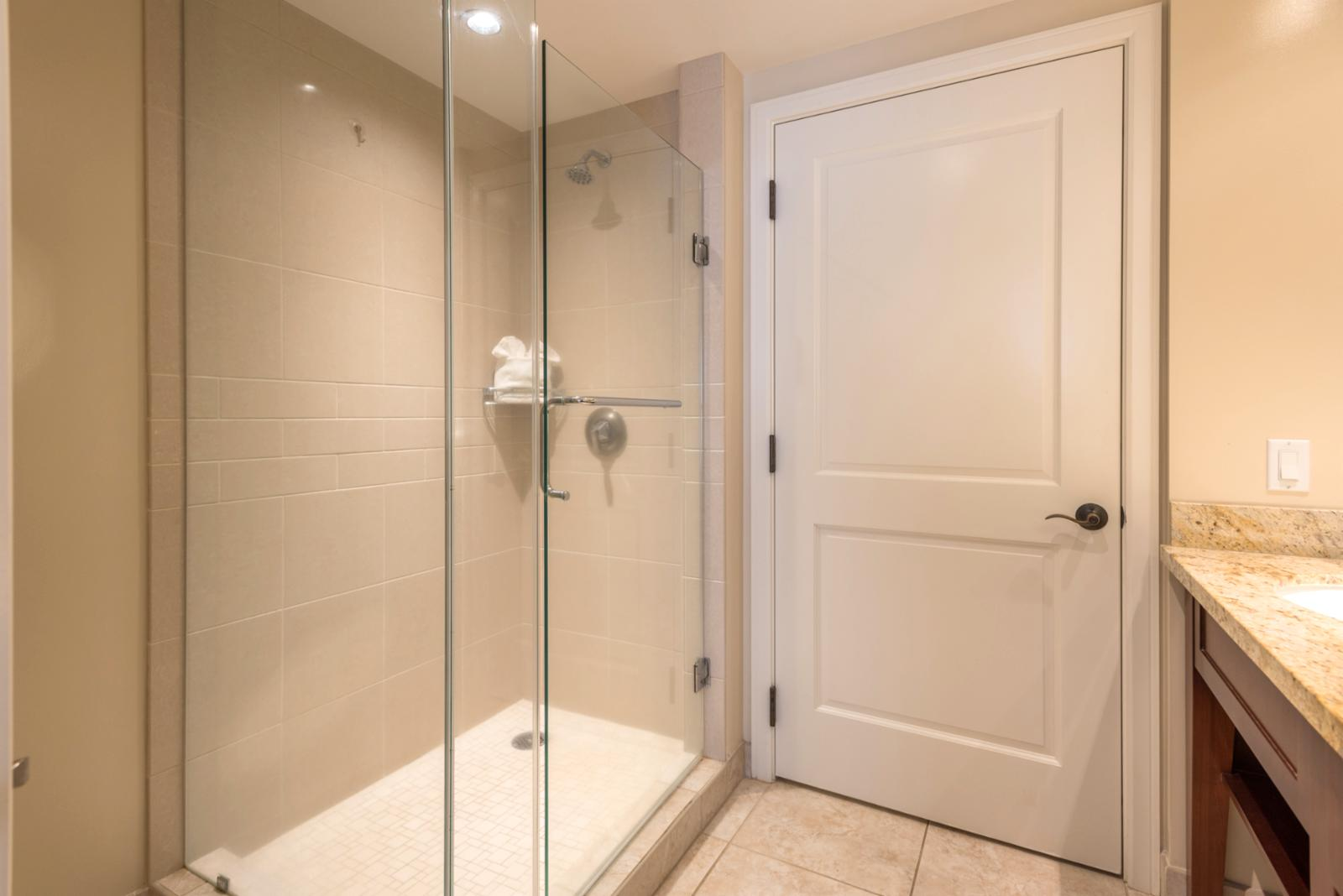 Glass enclosed shower from floor to ceiling