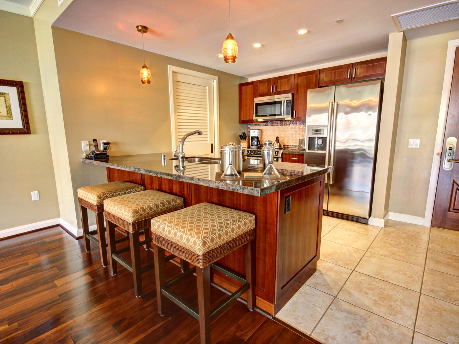 Sit and enjoy a casual meal or a cold libation at this kitchen counter.