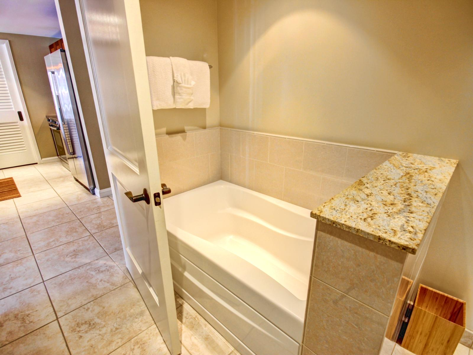 Separate bathtub in the guest bathroom with access from living room and the bedroom.