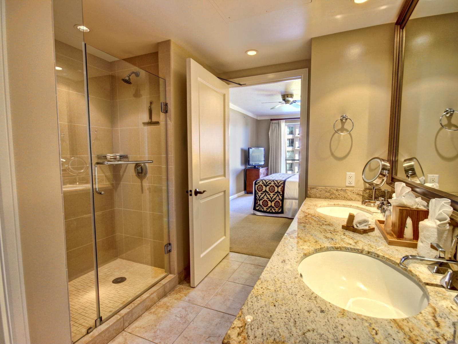 Large master bathroom with dual sink and an oversized vanity mirror.
