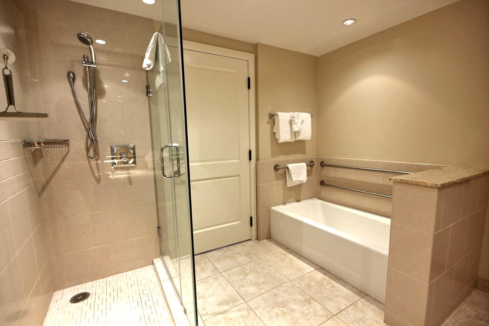 Separate bathtub and glassed in shower