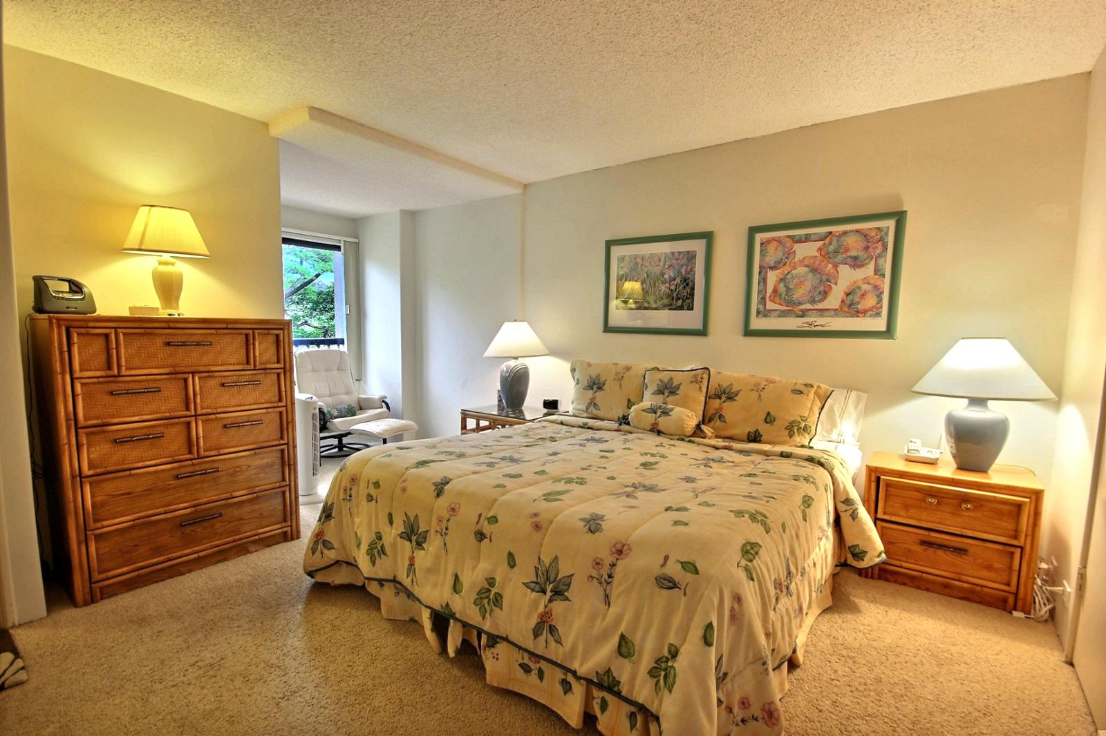 Large guest bedroom with king size bed.