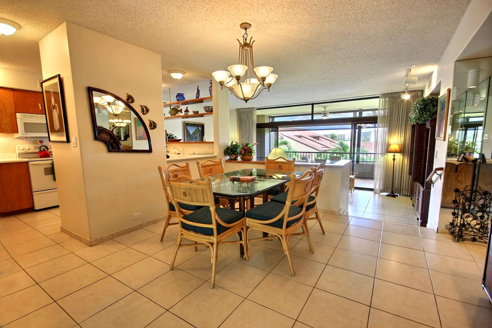 Large dining room table off the kitchen with seating for six