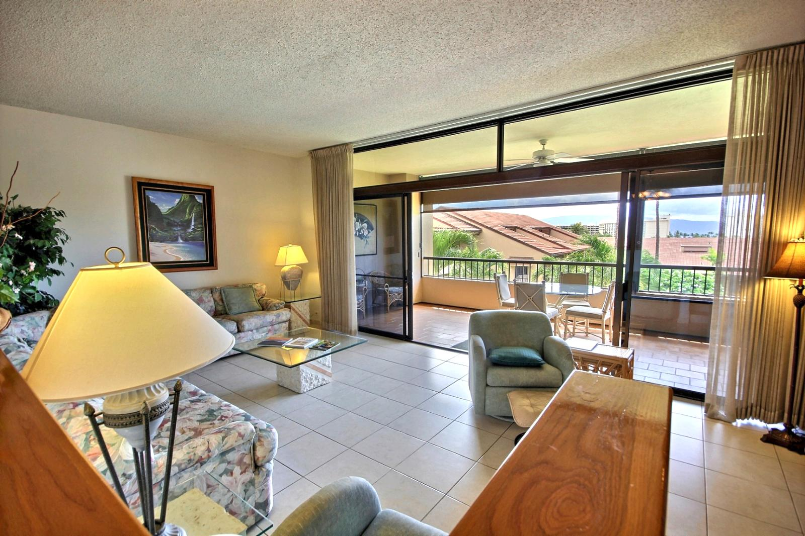 Looking down into the living room and out to the large lanai.