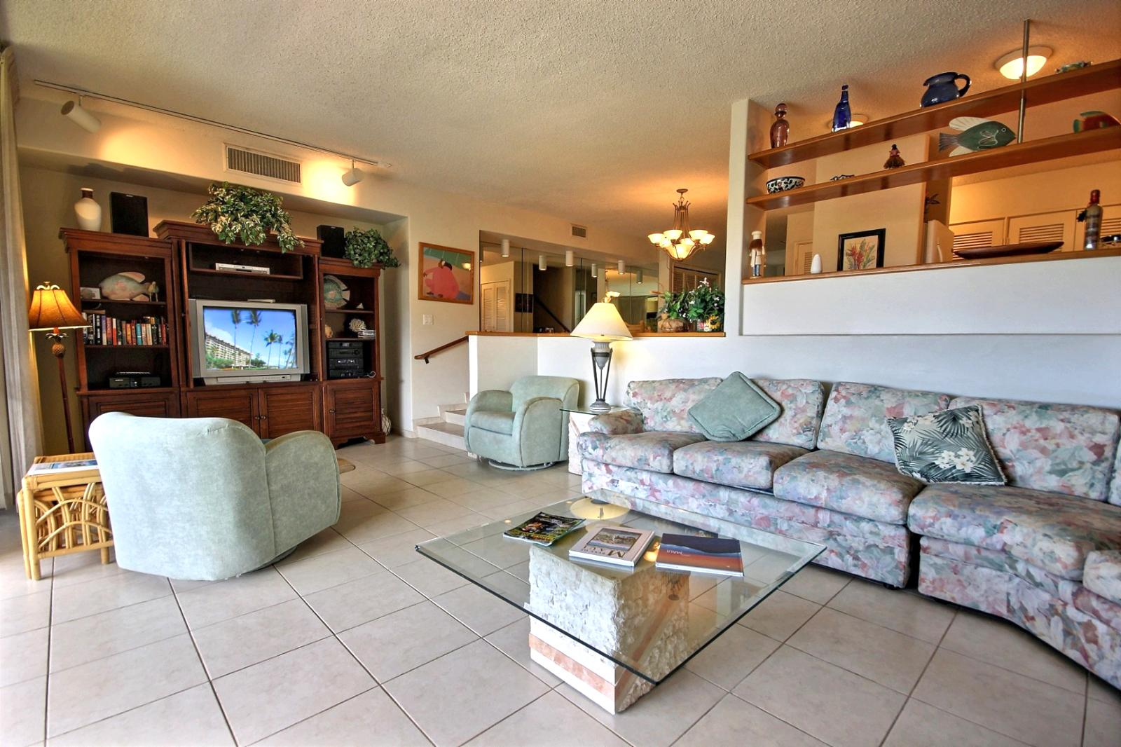 Big open living space that has a large L shaped queen sofa bed couch.