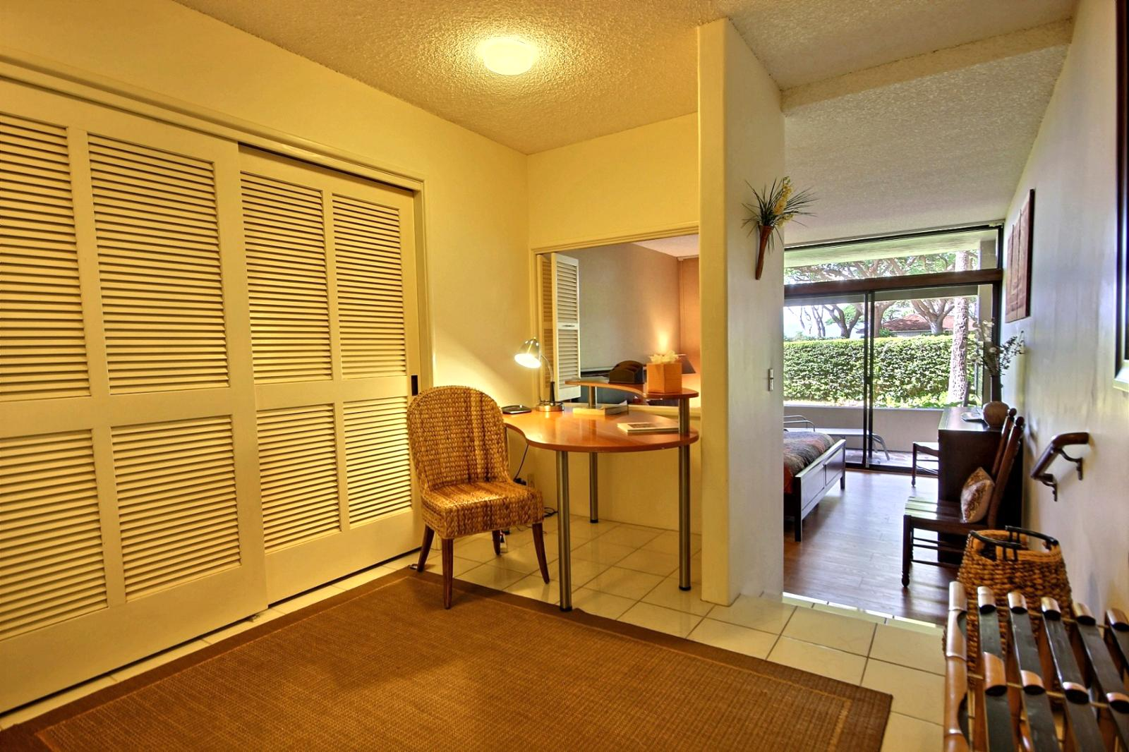 As you enter the master bedroom there is a small office nook then it steps down to bedroom.