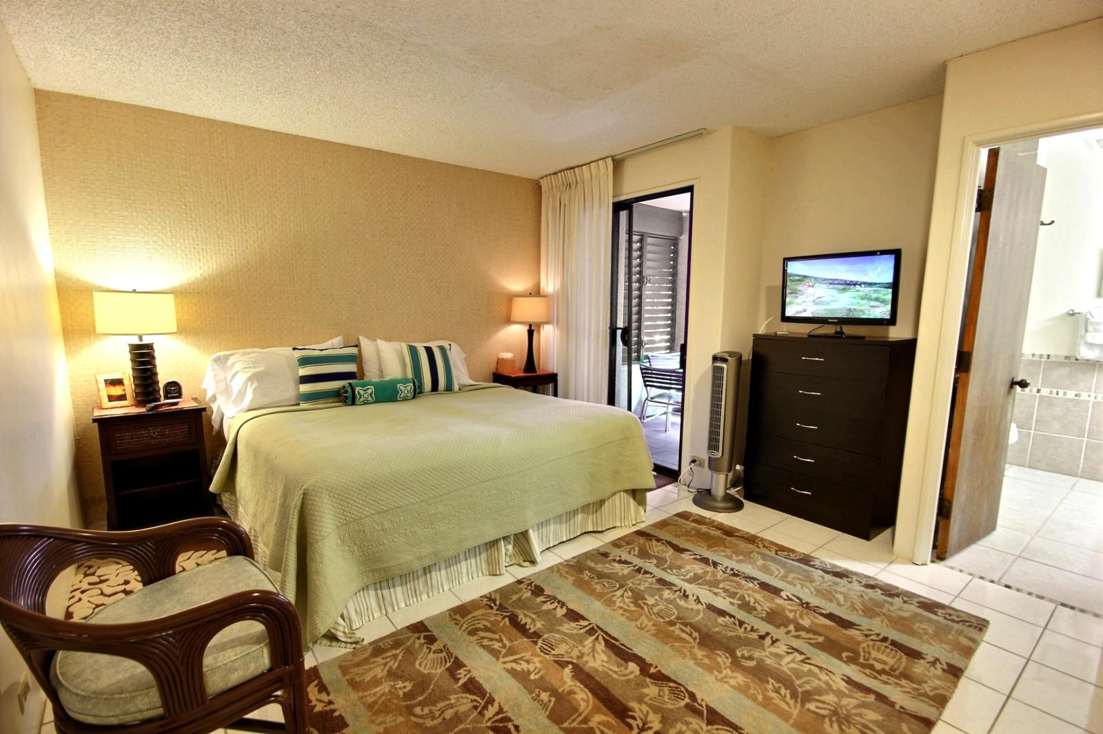 Large guest bedroom with small private lanai.