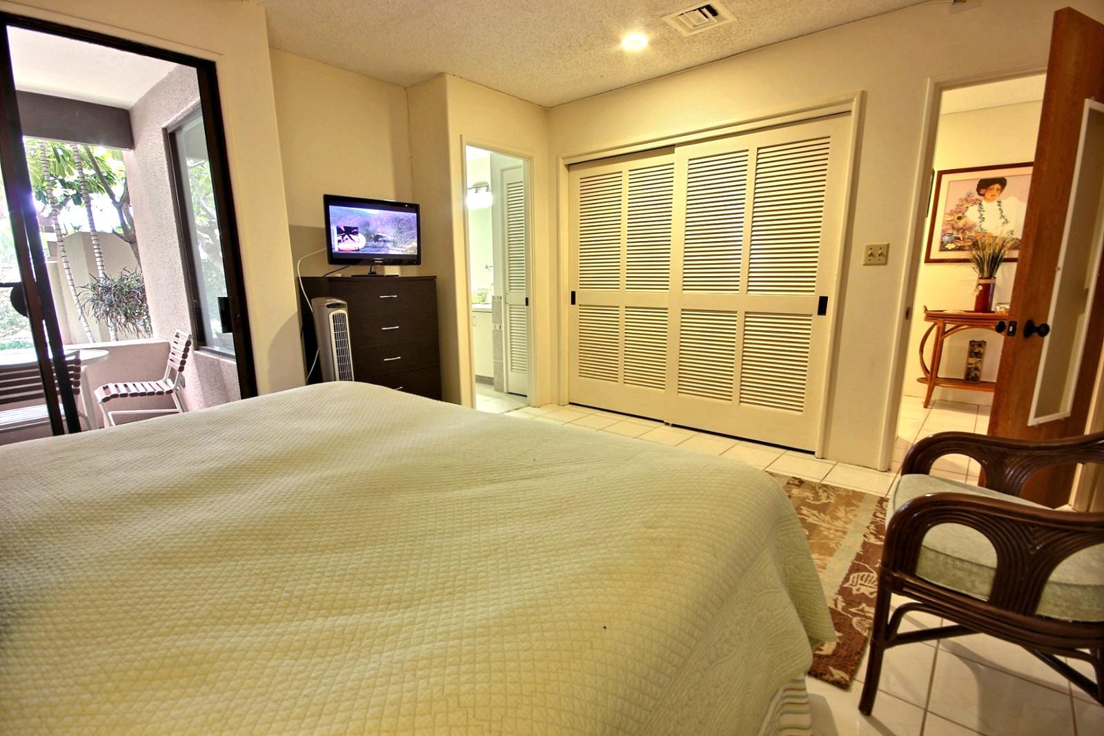 Guest bedroom gets great natural light with a small flat screen TV