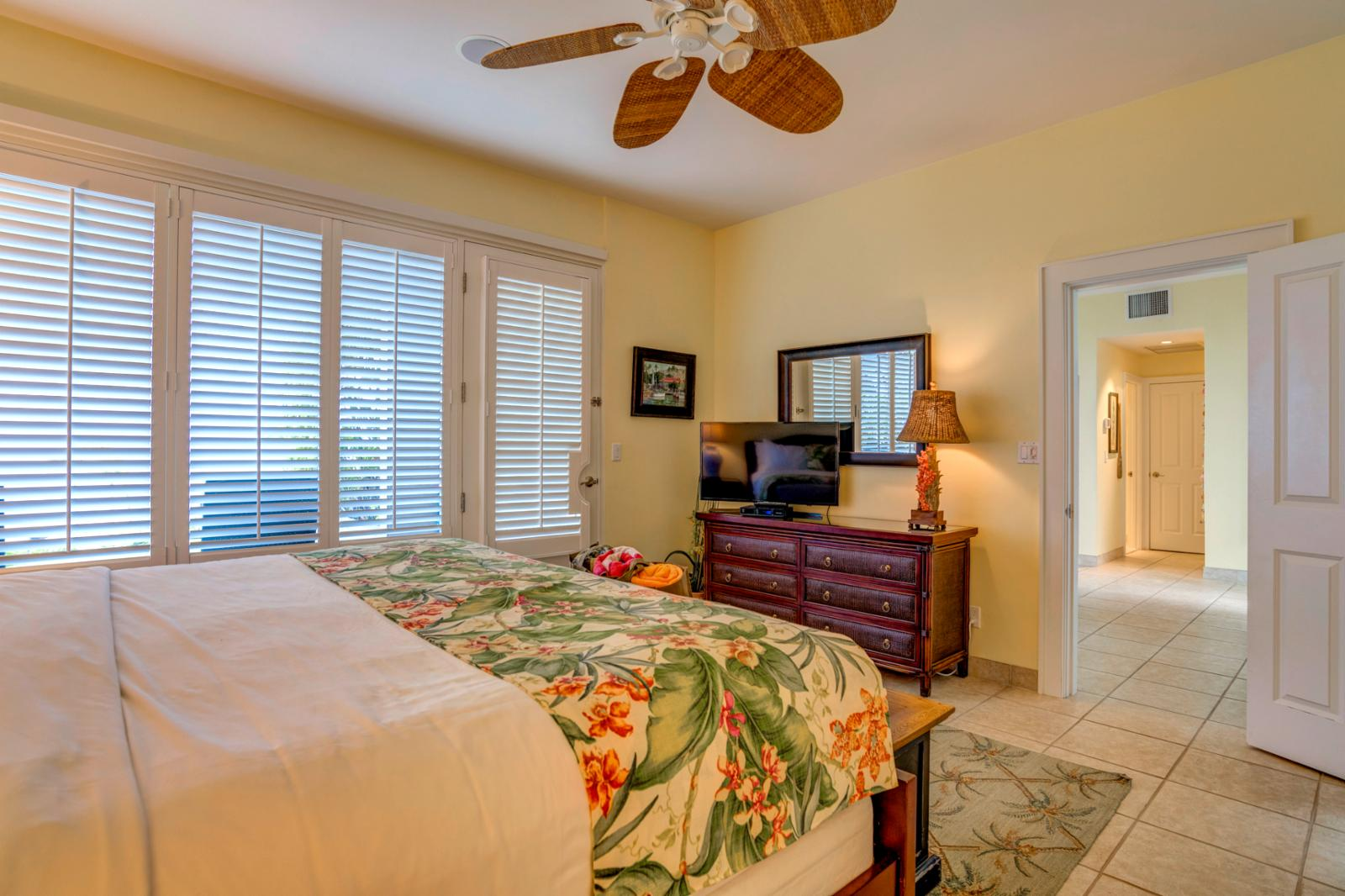 Master suite, new furnishings, equipped with ceiling fan, and large flat screen television