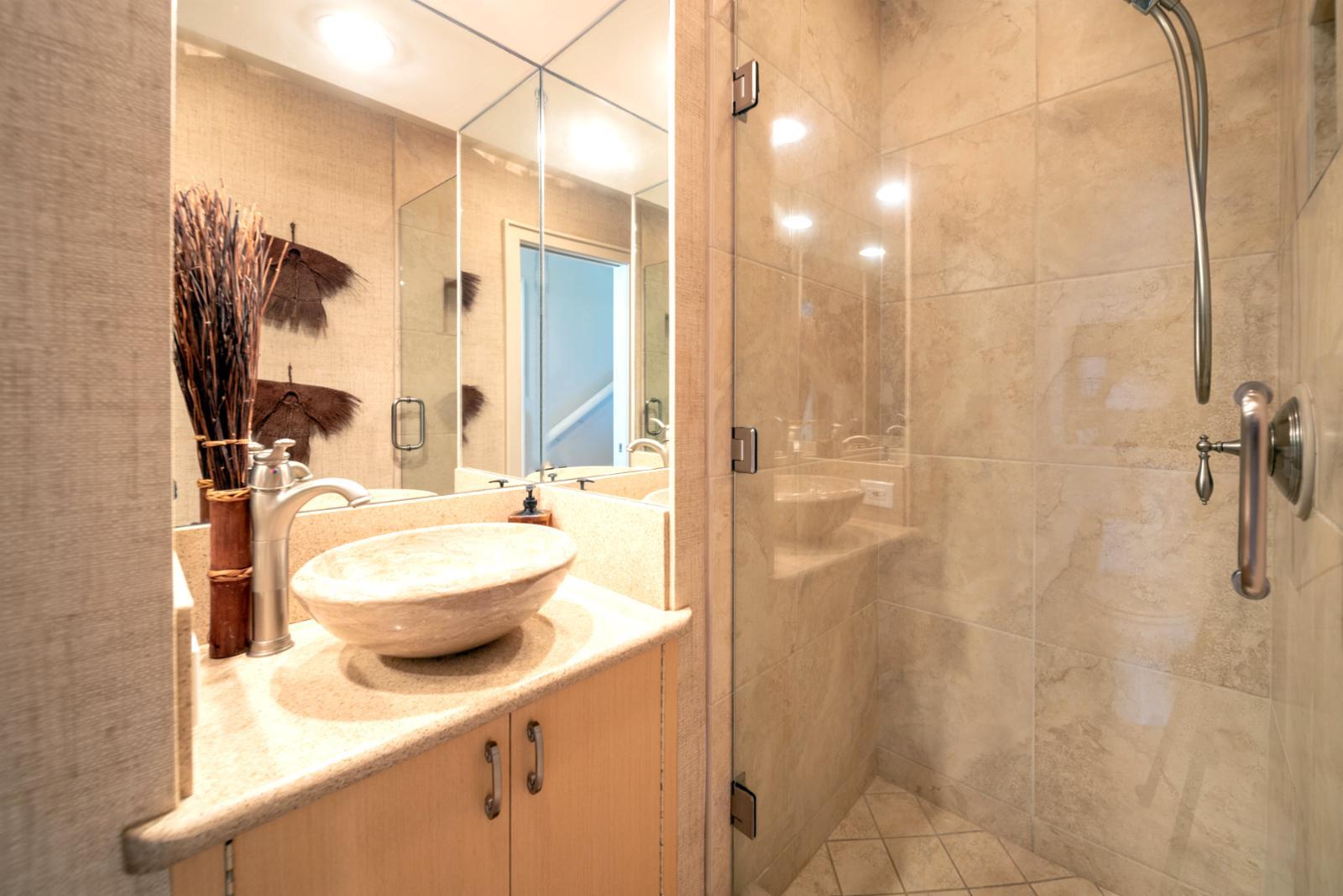 Custom guest bath finishings with upgraded lighting