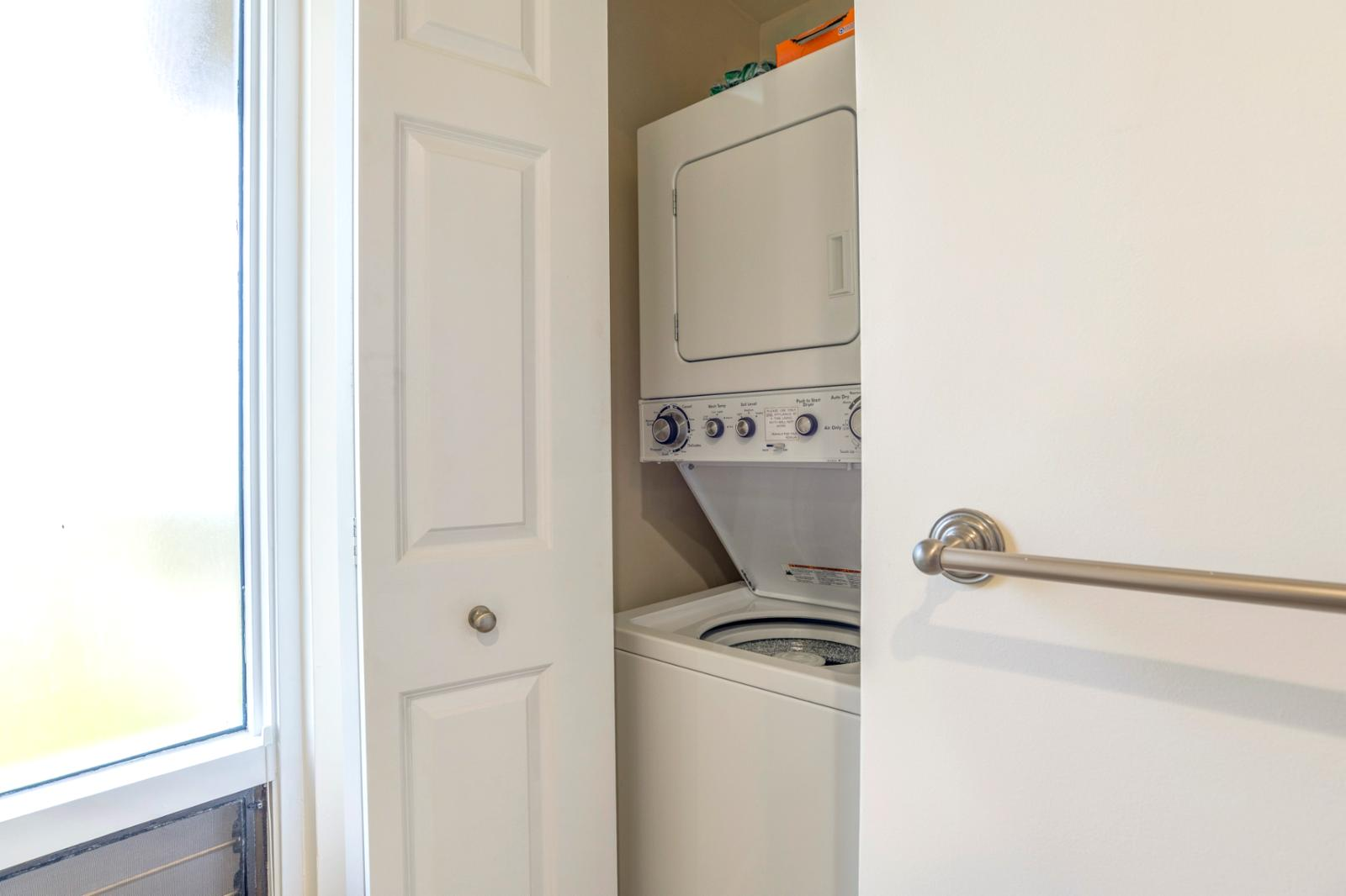 Stackable washer and dryer located in guest bath 3