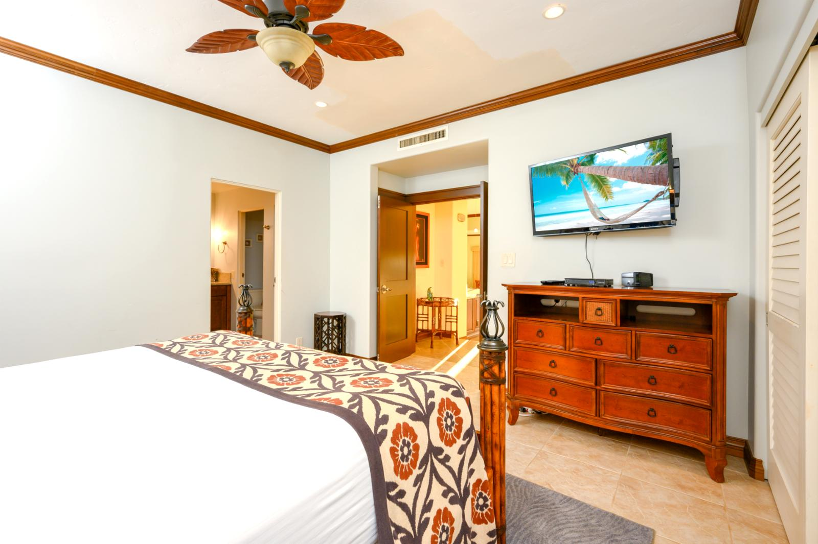 Guest bedroom with flat-screen tv