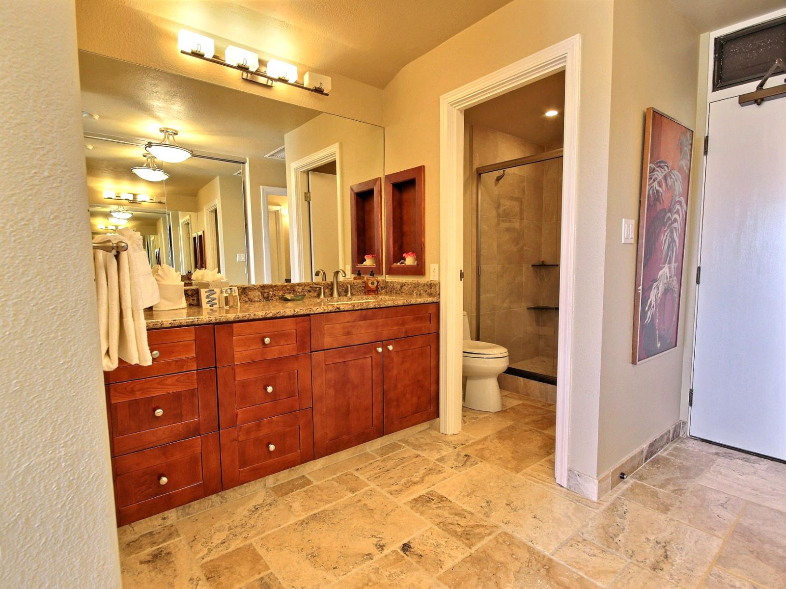 Beautiful guest bathroom with travertine and marble