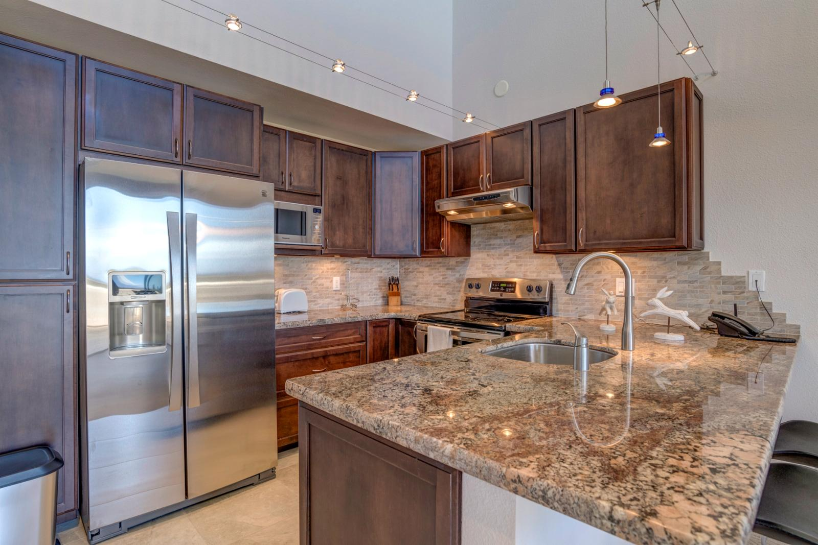 Upgraded kitchen with luxury back splash and granite finishings